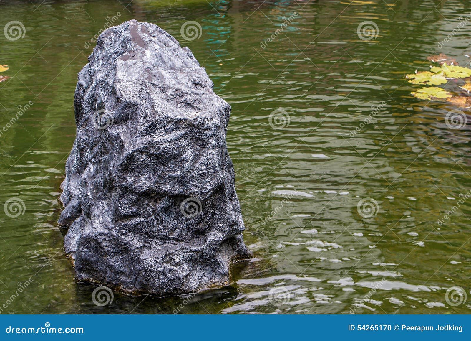 Charming Big Black Stones In Water Garden Background