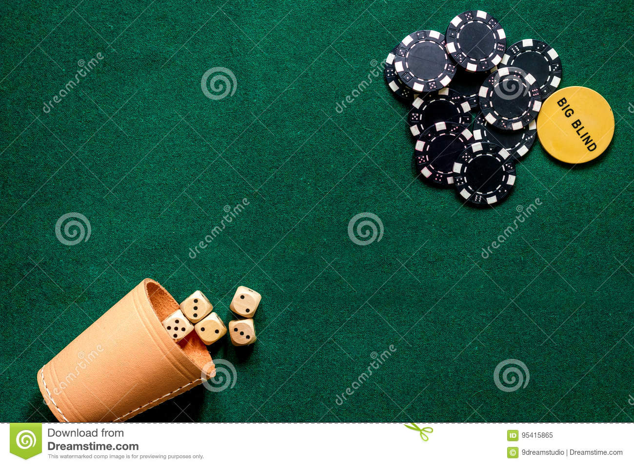 Big Blind Poker Chips And Dices On A Green Gaming Table Top