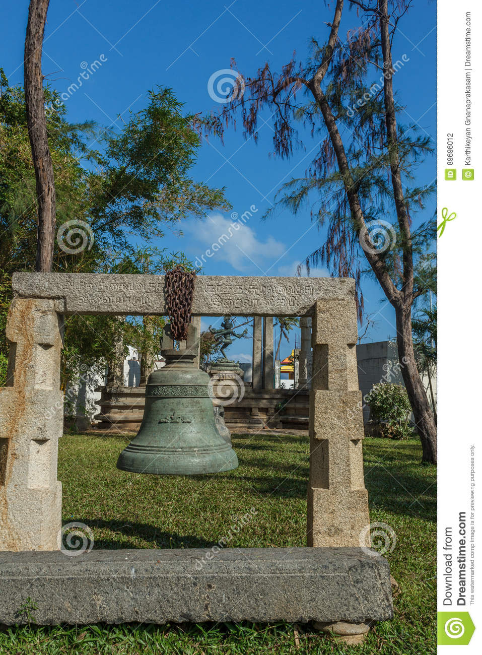 Big Bronze And Iron Bell With Carvings Hanging From Concrete Support