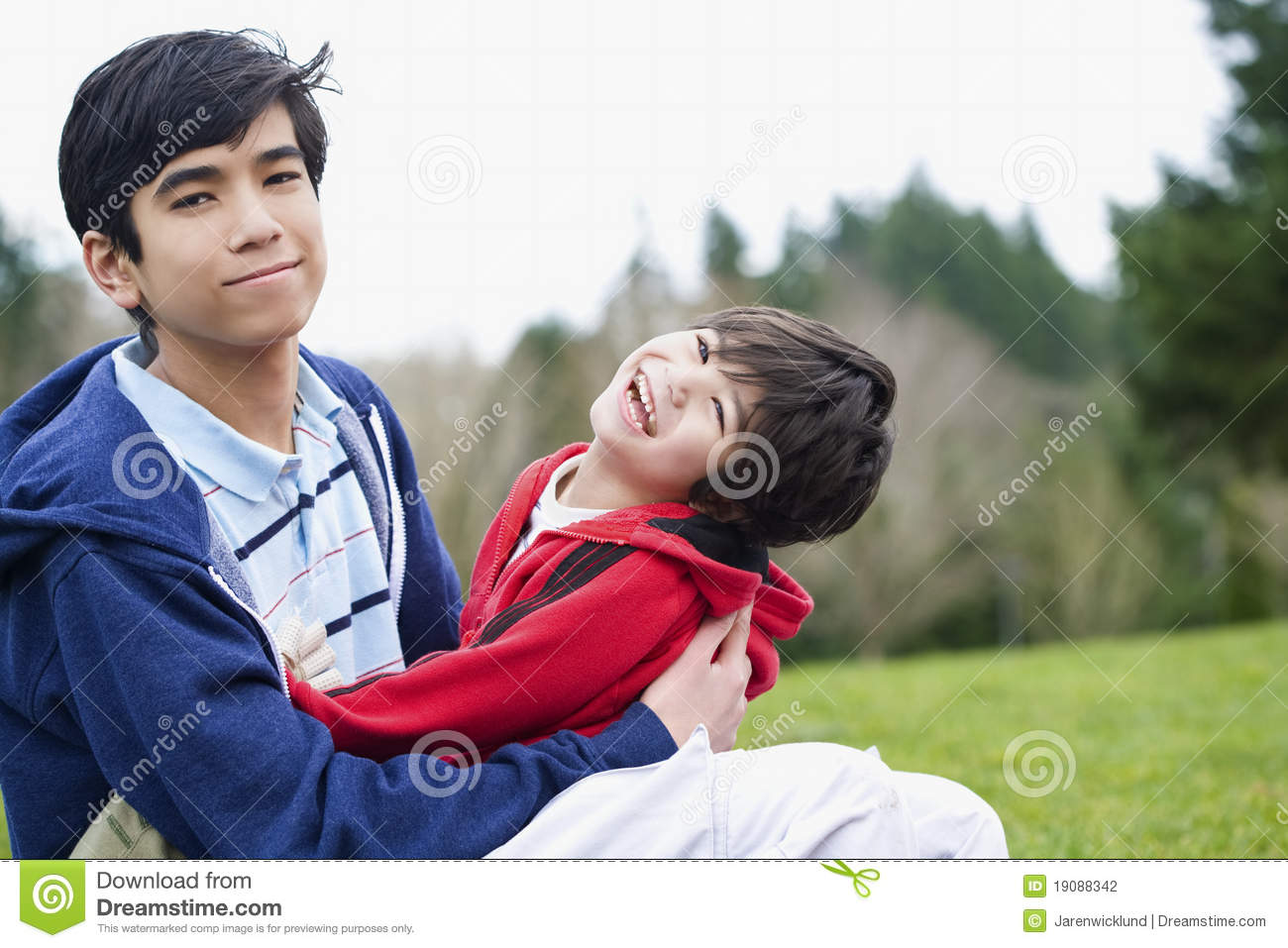 Big Brother Taking Care Of Disabled Brother Stock Photo - Image Of Children, Biracial -9495