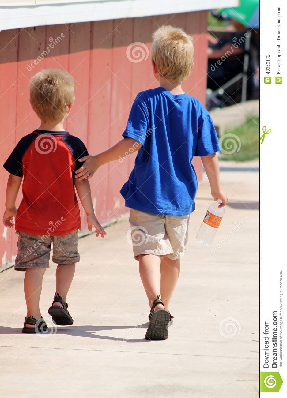 Big Brother Taking Care Of Little Brother Stock Photo