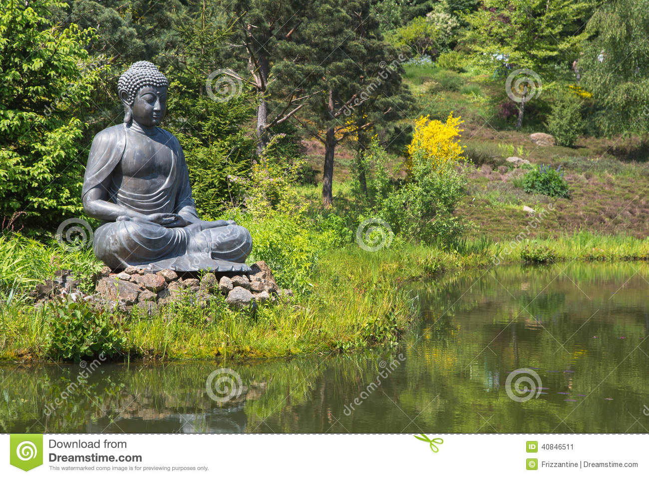Big Buddha Statue Next To The Garden Pond.