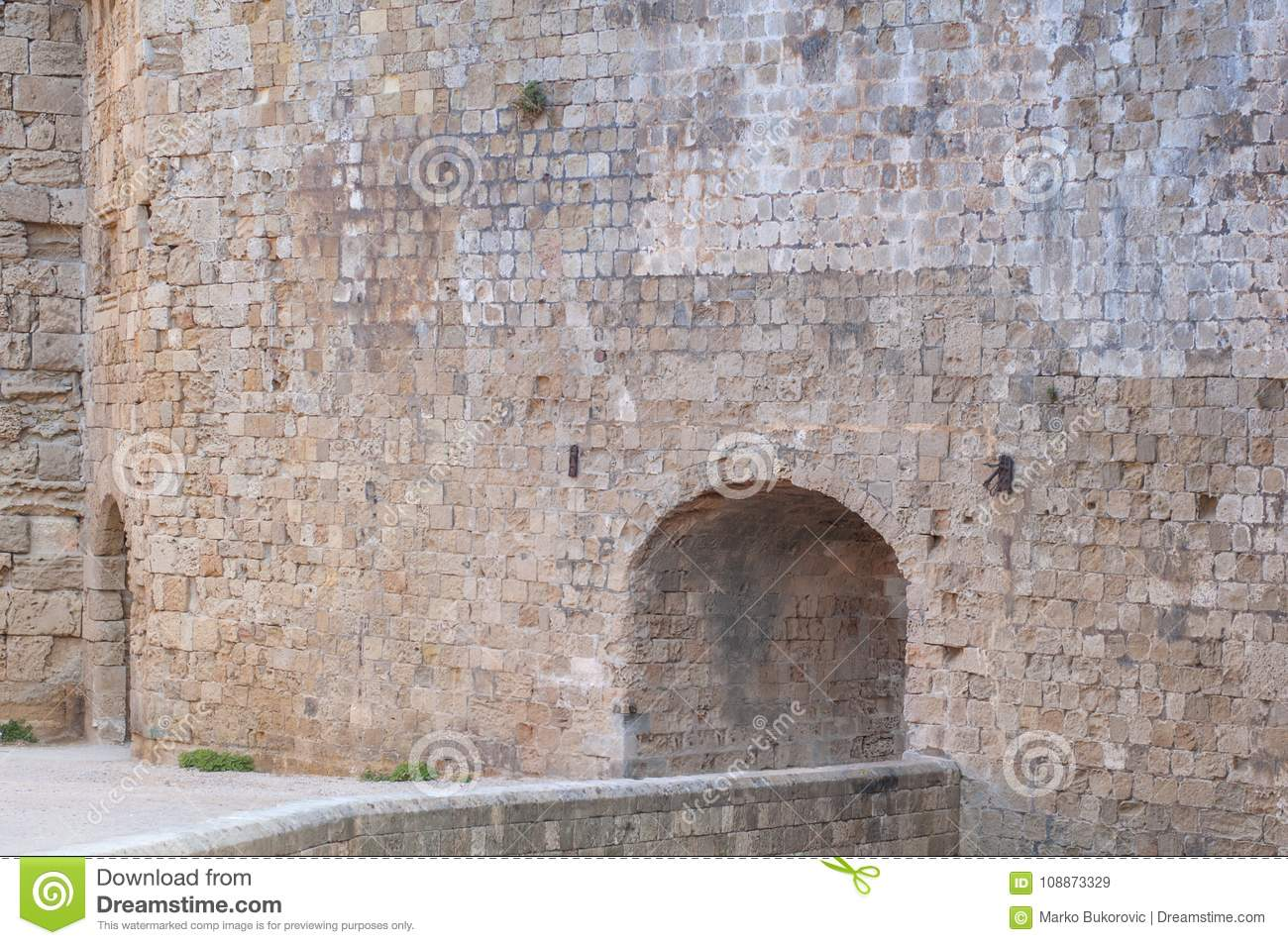 Big castle wall stone architecture building with entrance detail