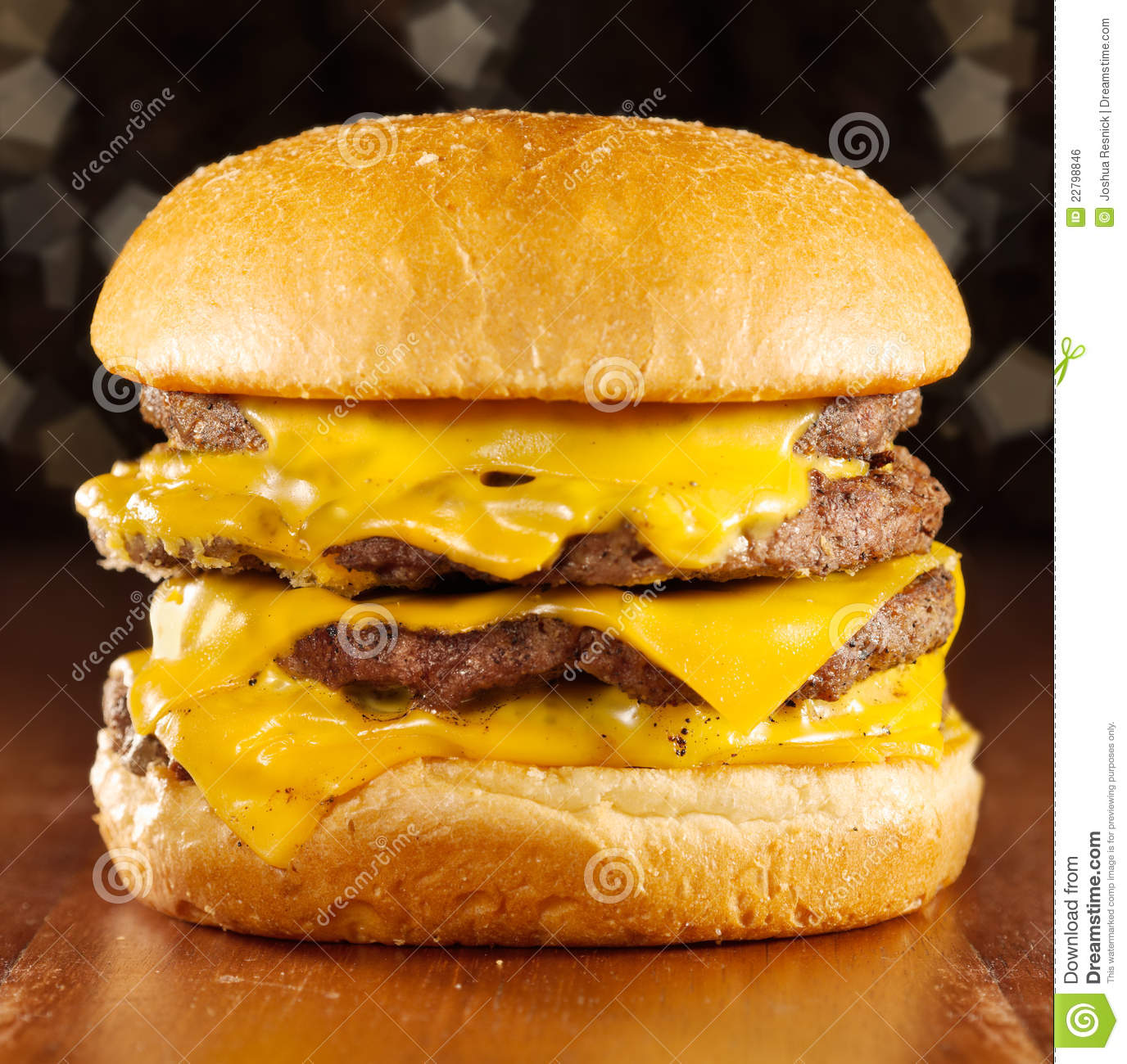 Photo of a big cheeseburger with melted cheese and glittery background ...
