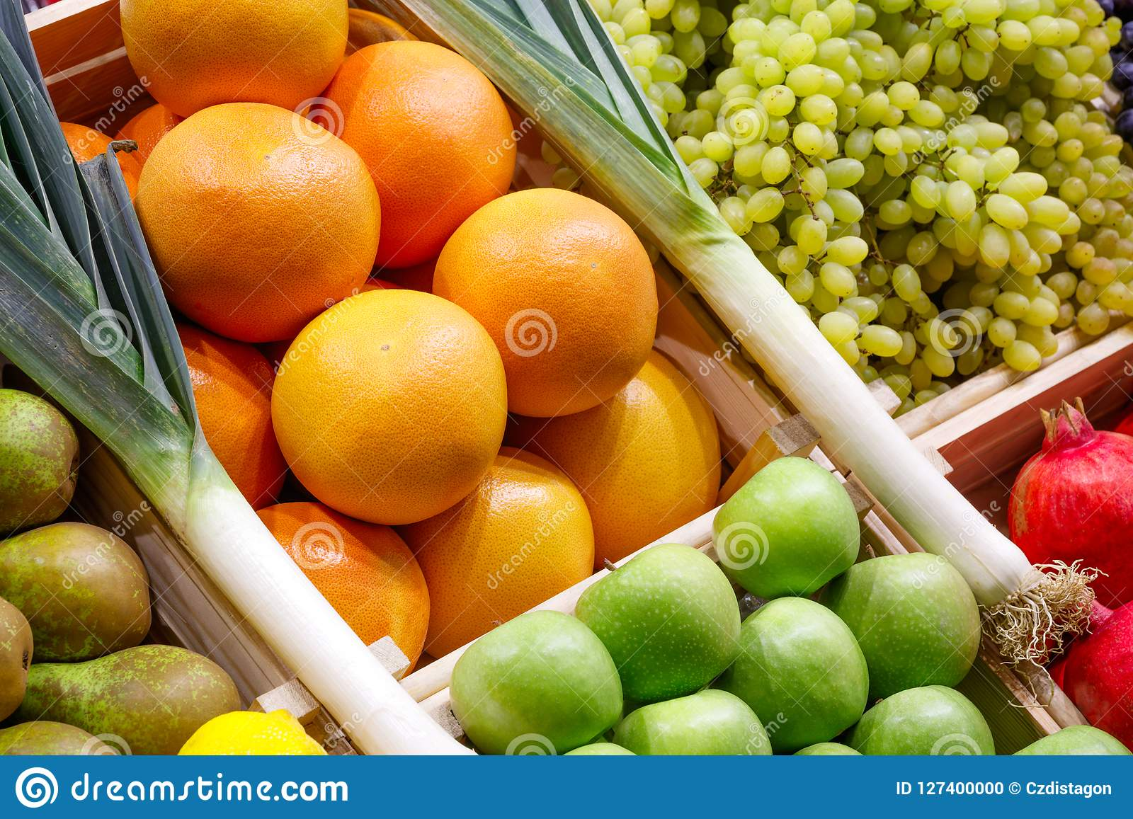 Big choice of fresh fruits and vegetables on market counter.