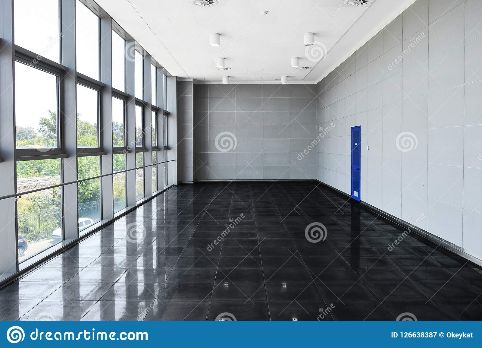 Big empty office space with window wall. Day light illumination.