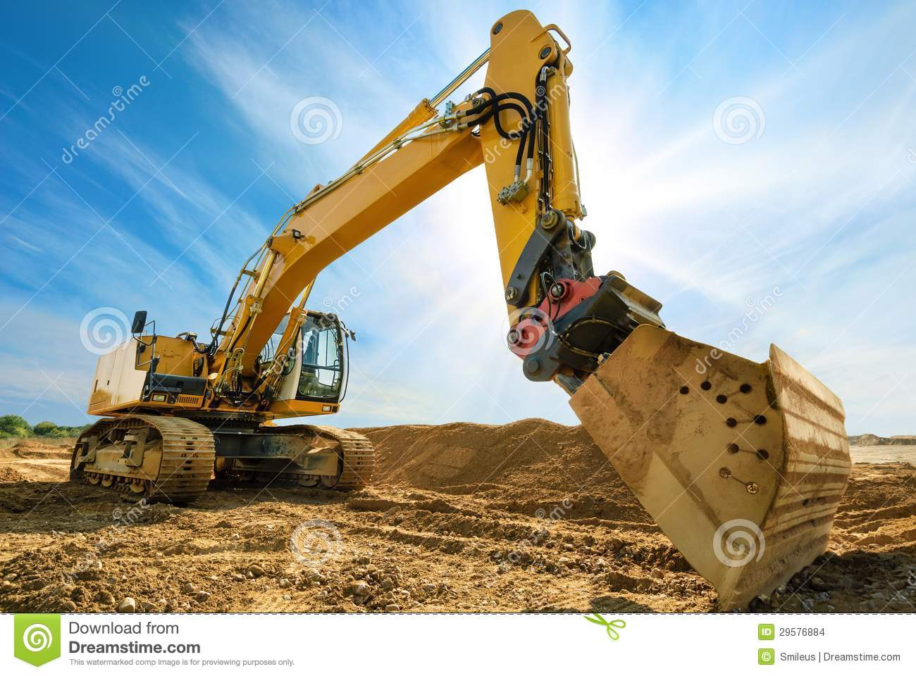 Big excavator in front of the blue sky