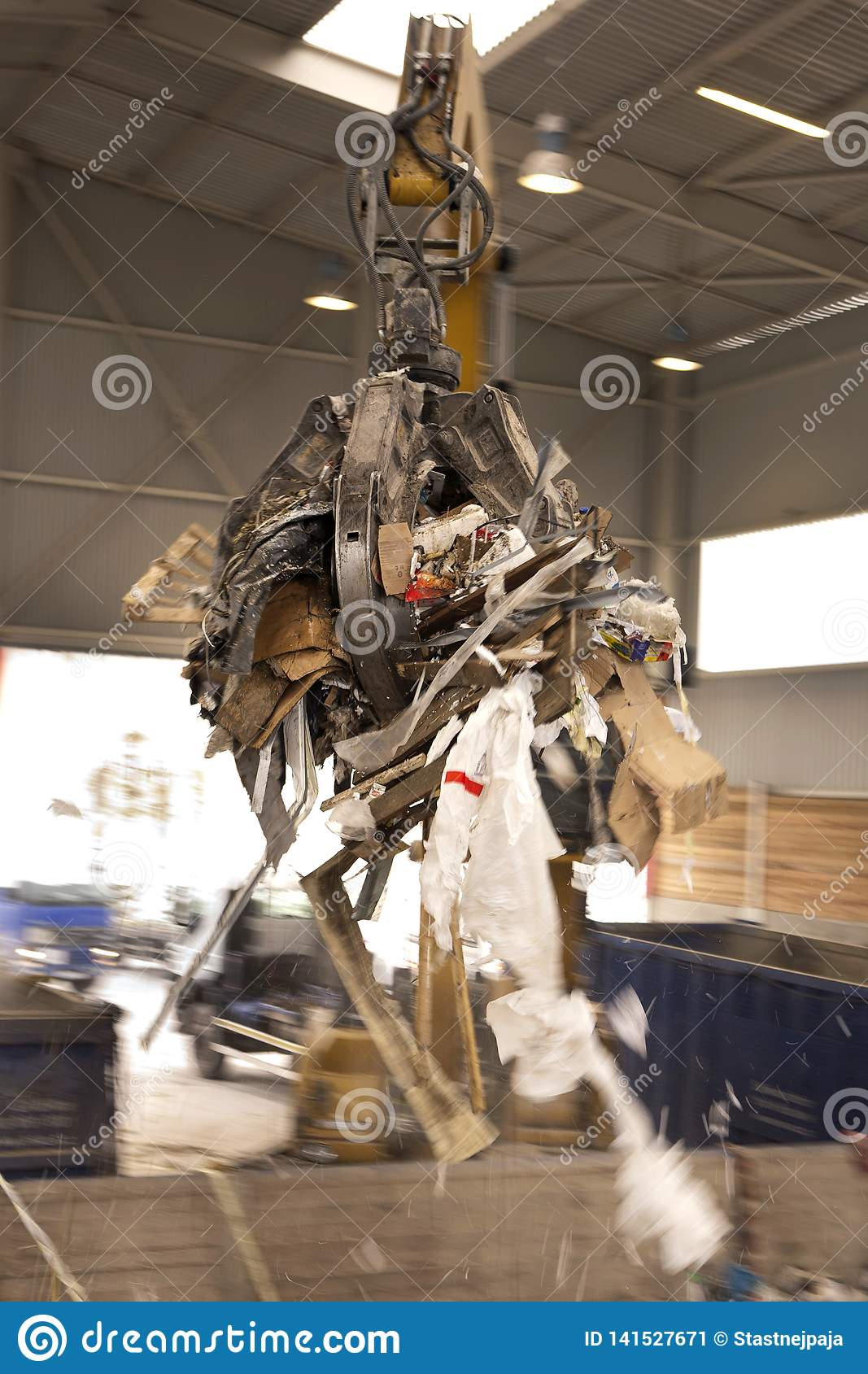 The grab takes the rubbish and move it to the incinerator where all waste is burned. Grab taking waste for burning it in the incin