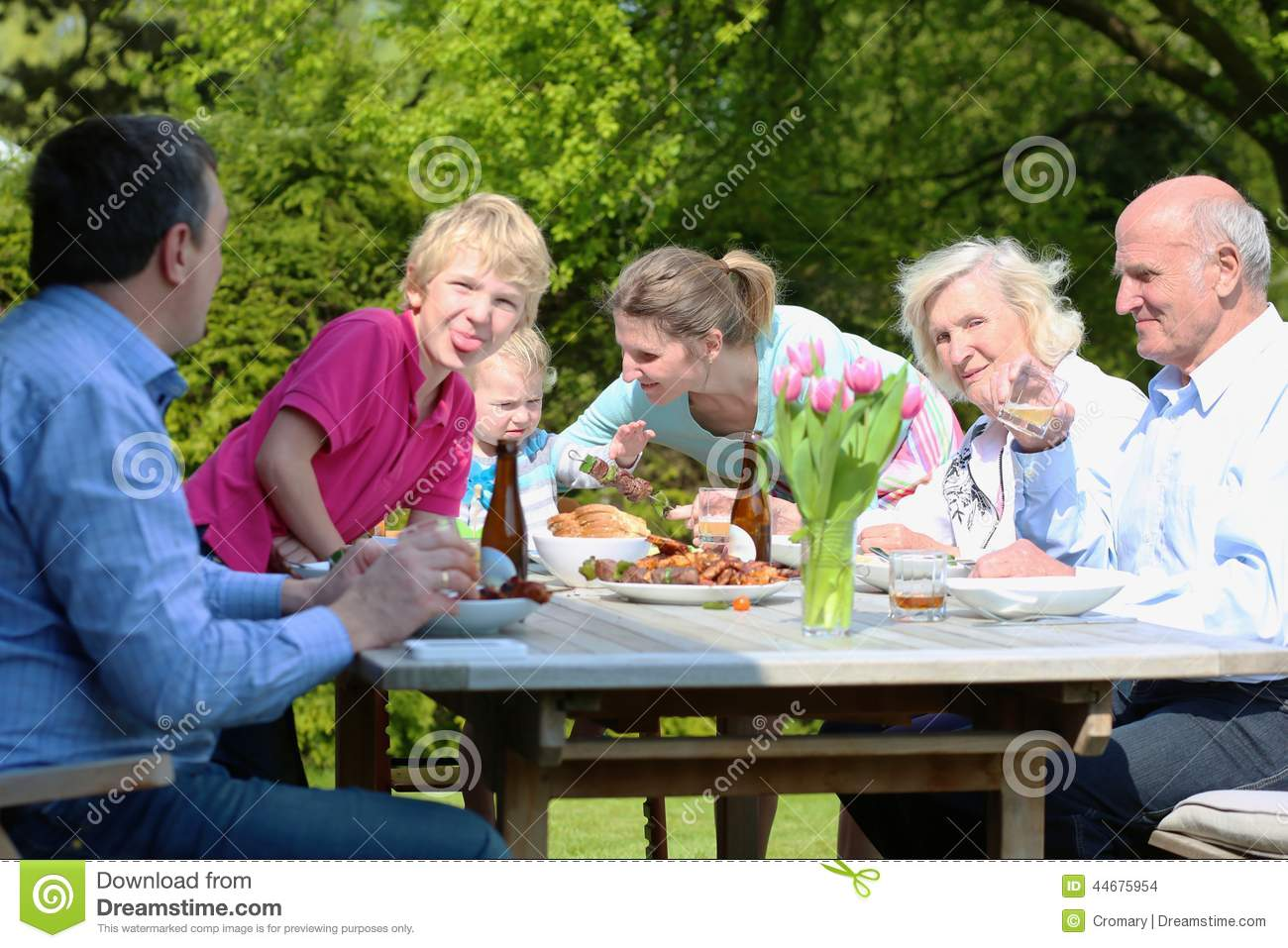 Big Family Having Lunch In The Garden Stock Photo - Image ...