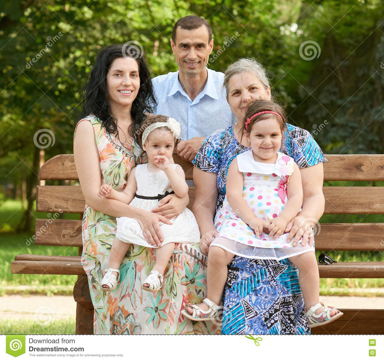 Terrific Big Family Sit On Wooden Bench In City Park Summer Season Bralicious Painted Fabric Chair Ideas Braliciousco