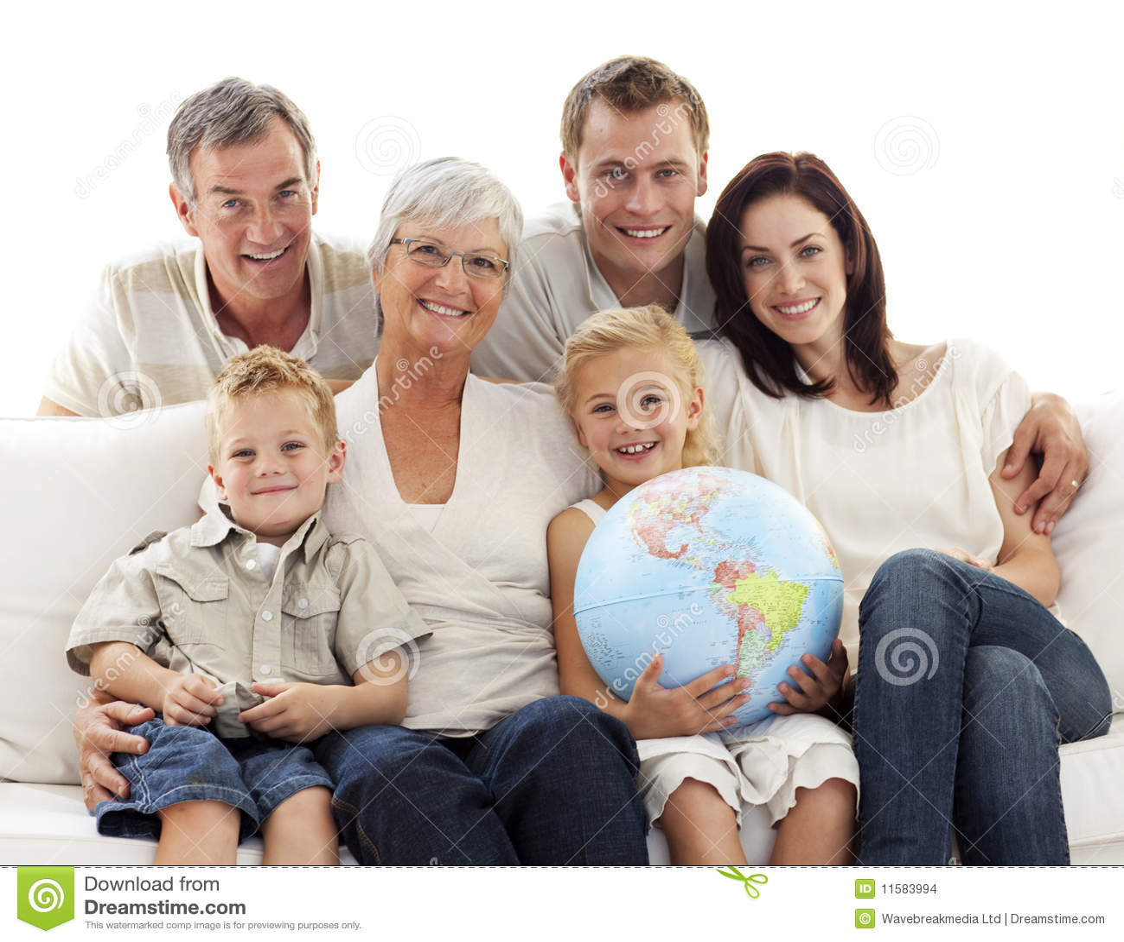 Big family on sofa holding a terrestrial globe