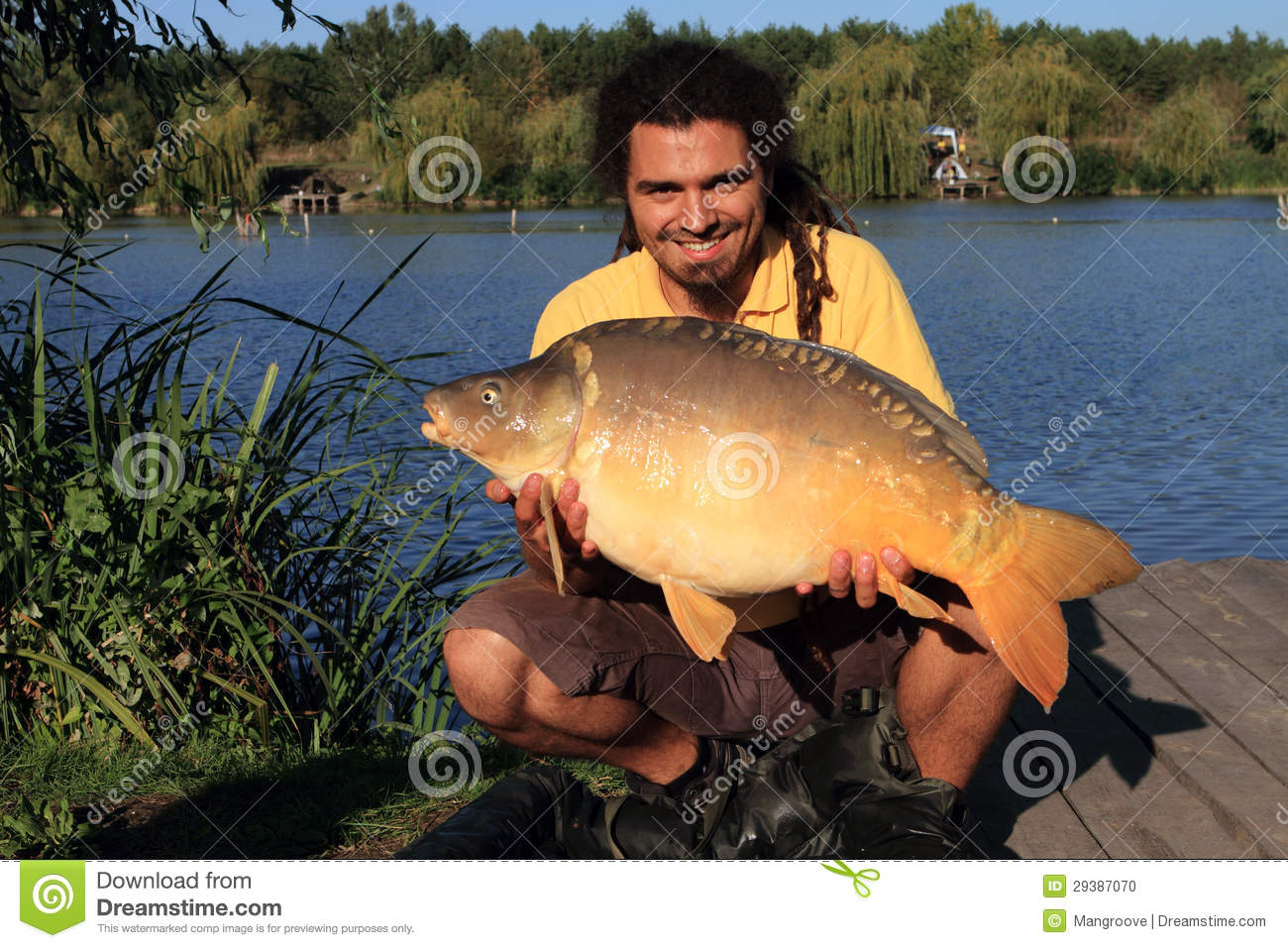 Big fish capture by fishing stock photo image 29387070 for A big fish