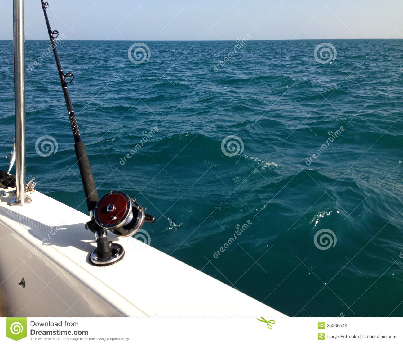 Big game fishing reels and rods stock images image 35265544 for Big game fishing rods