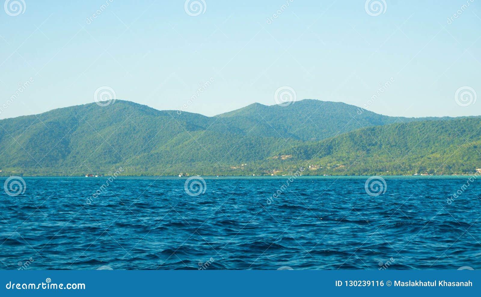 A Big Green Island With Deep Blue Dark Sea In Karimun Jawa Island