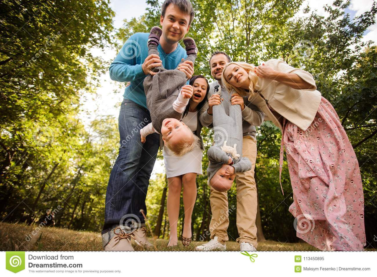 Big And Happy Smiling Family Playing With Children In The