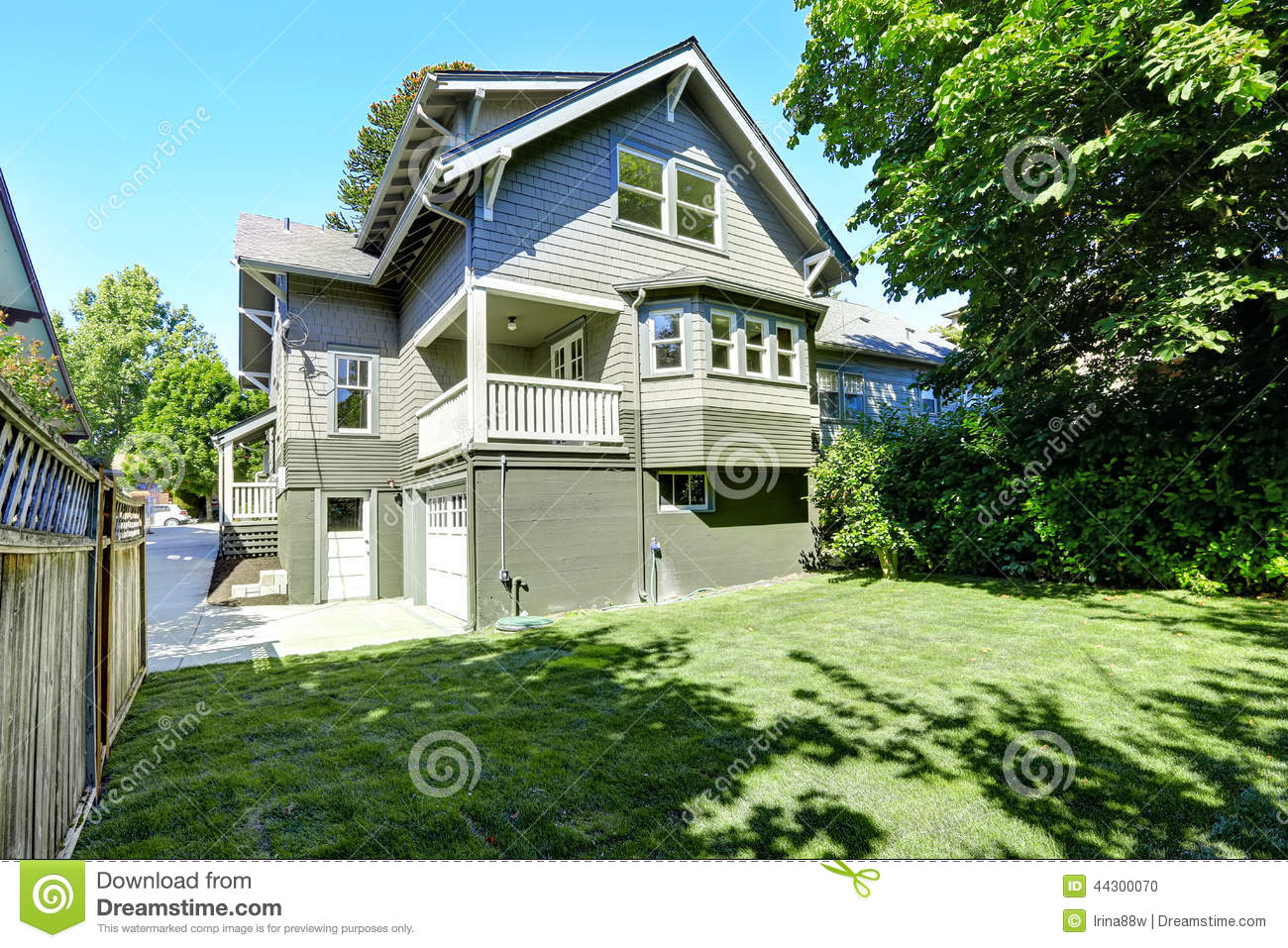 Big house with garage and driveway backyard view stock for American homes realty