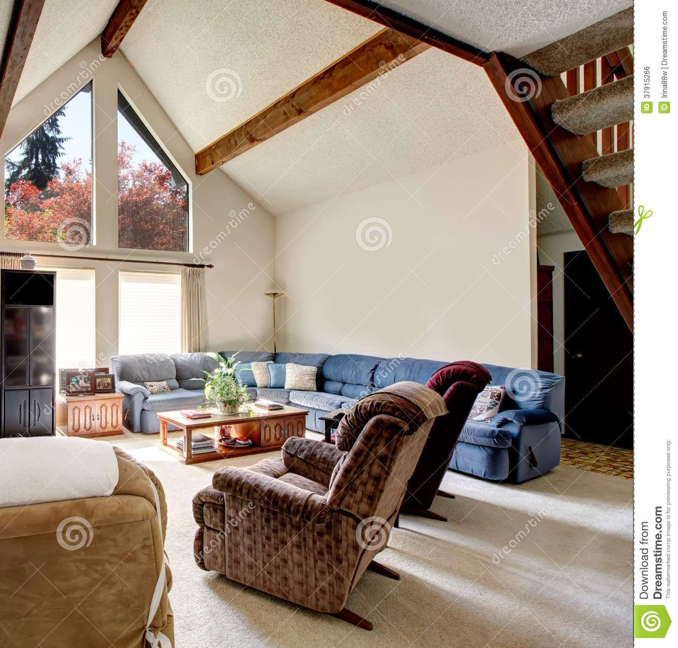 Big Log Cabin Style Living Room With Rocky Wall Design Stock