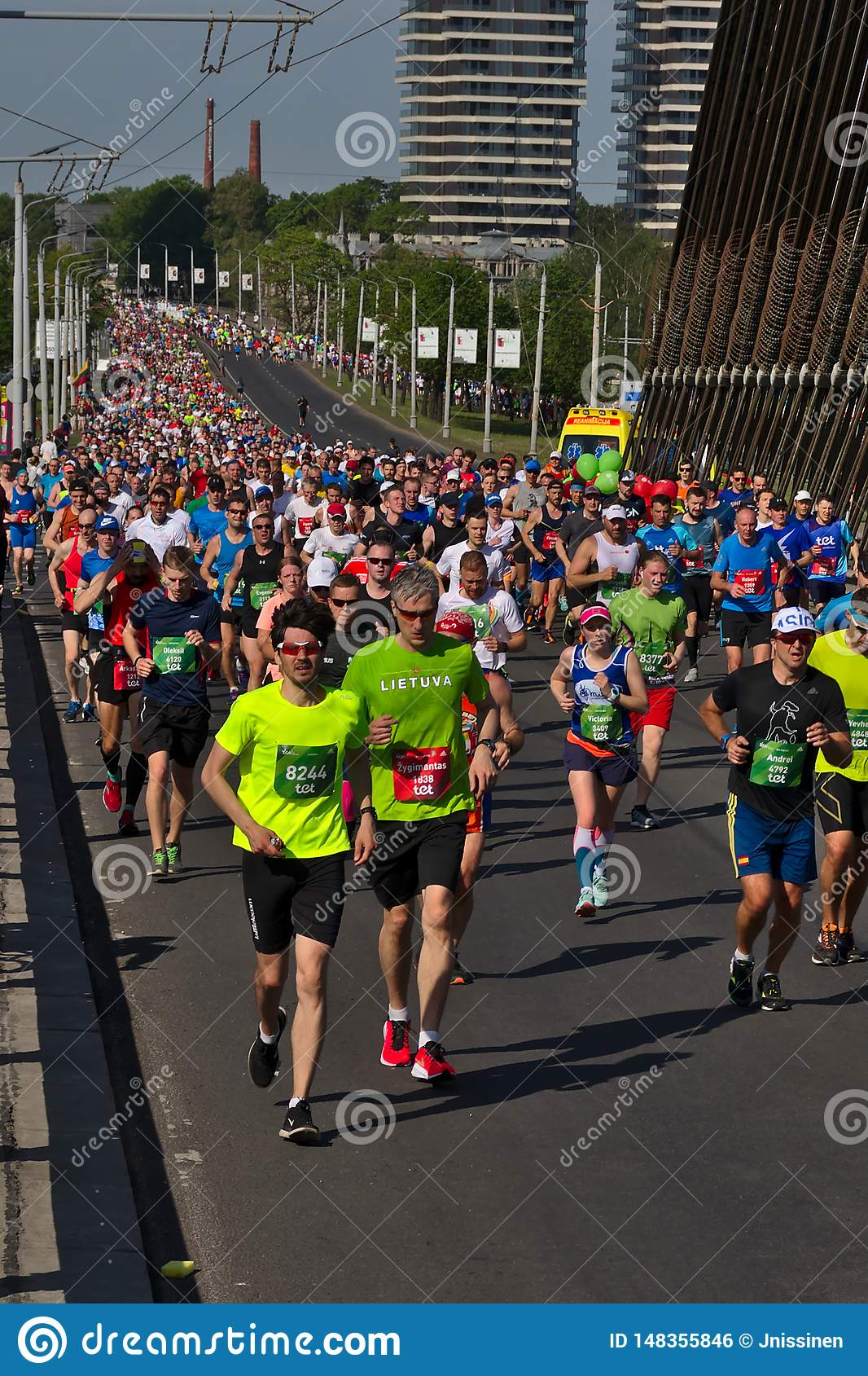 Riga, Latvia - May 19 2019: Big marathon crown running up to Vansu bridge