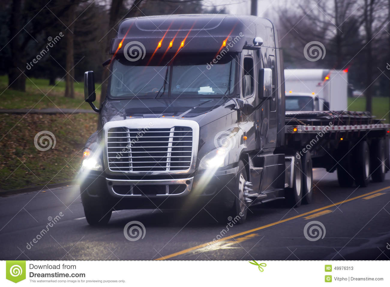 Picture Of Big Rig Headlights : Big modern semi truck with bright headlight and flat bed