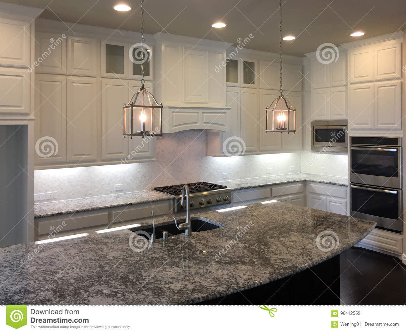 Picture of: Big New Kitchen With Island Counter Design Stock Photo Image Of Community Kitchenware 96412552