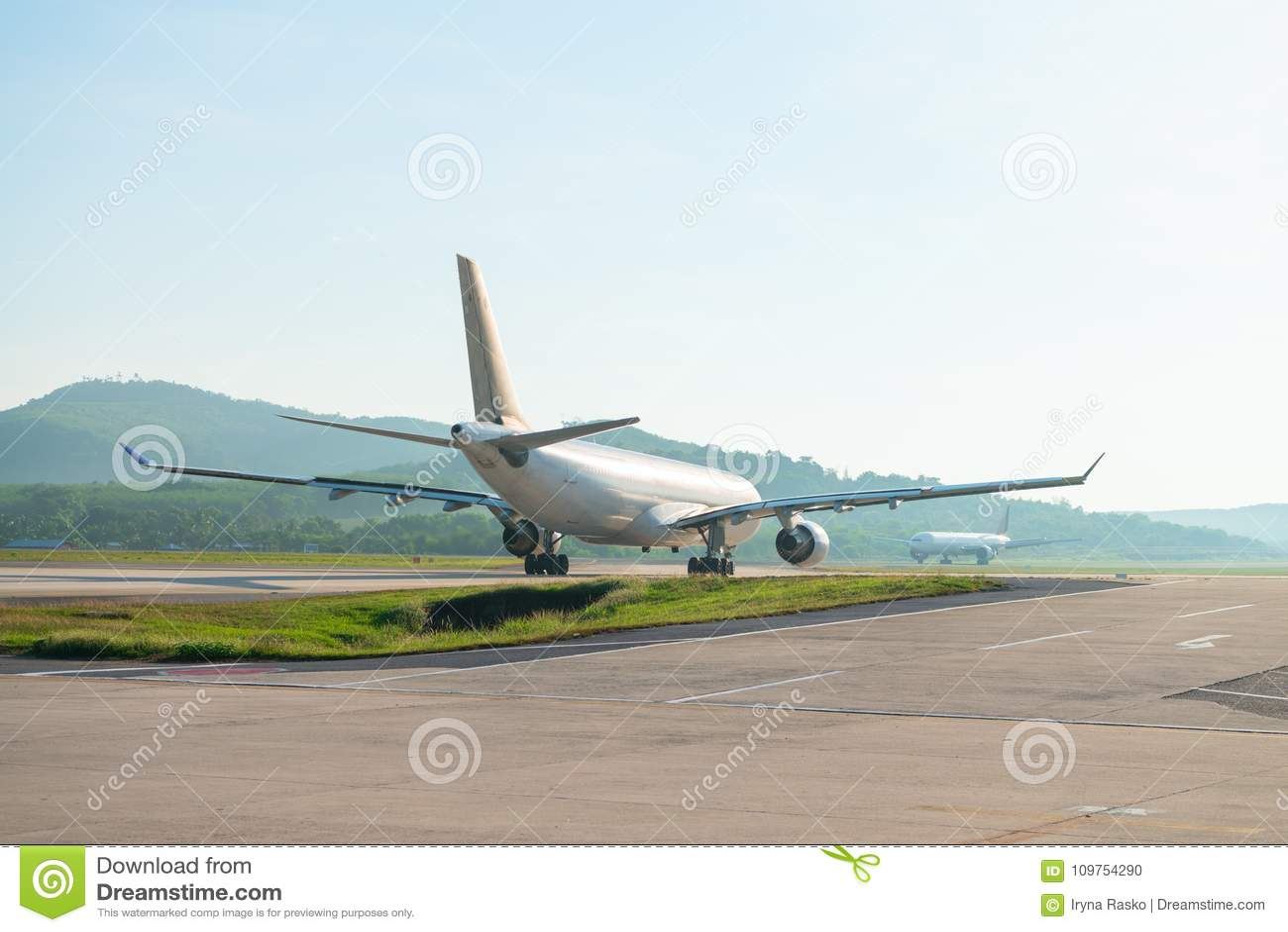 Big passenger airplanes on runway strip