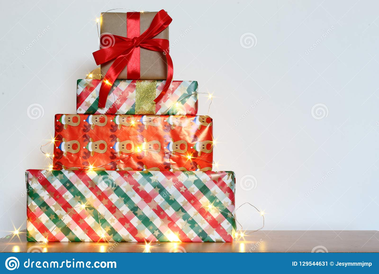 Big Pile Of Colorful Wrapped Gift Boxes Isolated On Wood Table And