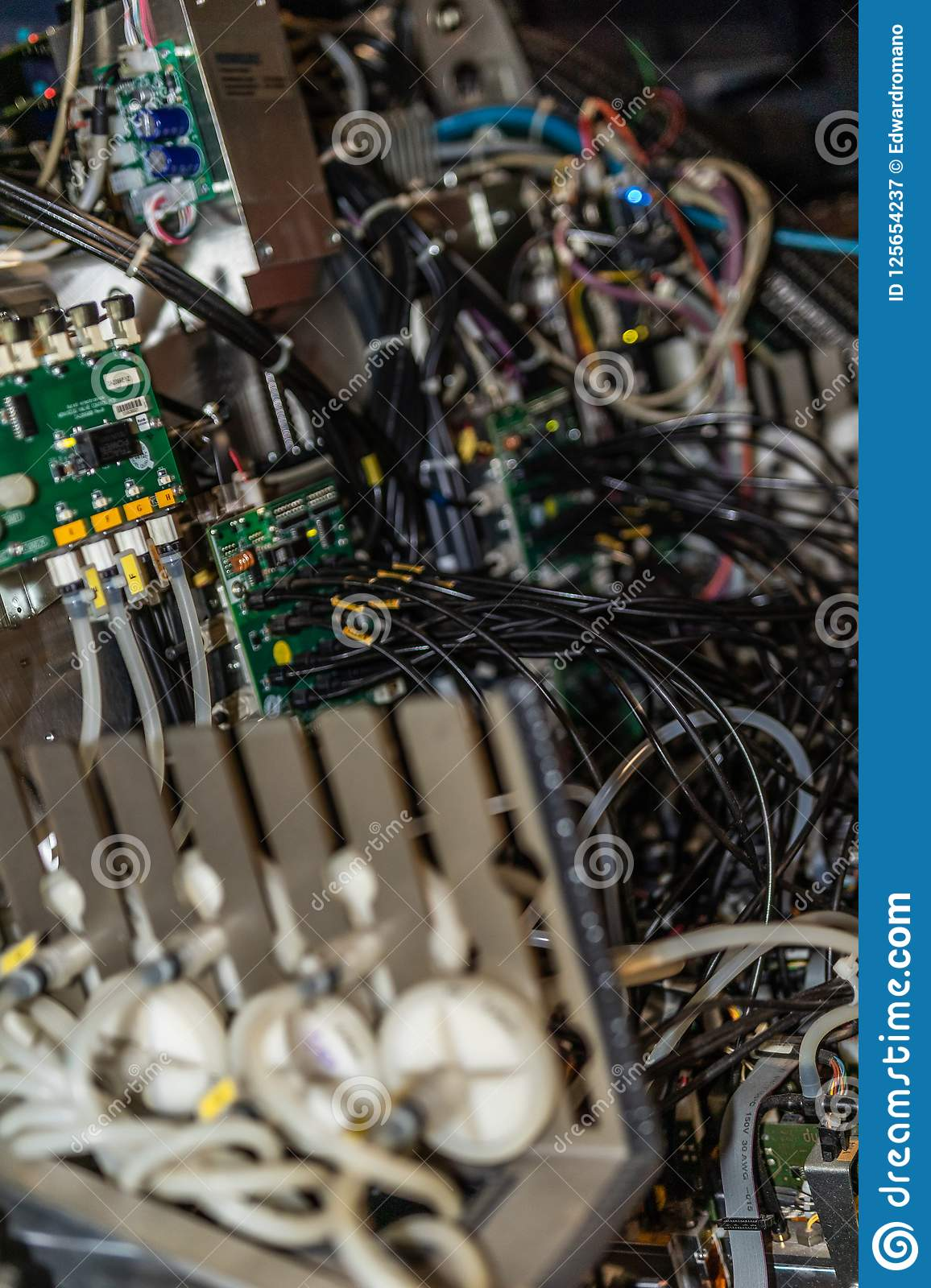 Big professional printer, detailed shot of the motherboard and the wiring system