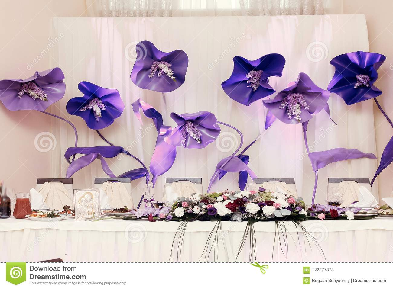 Big Purple Flowers At Wedding Centerpiece For Bride Groom Settin