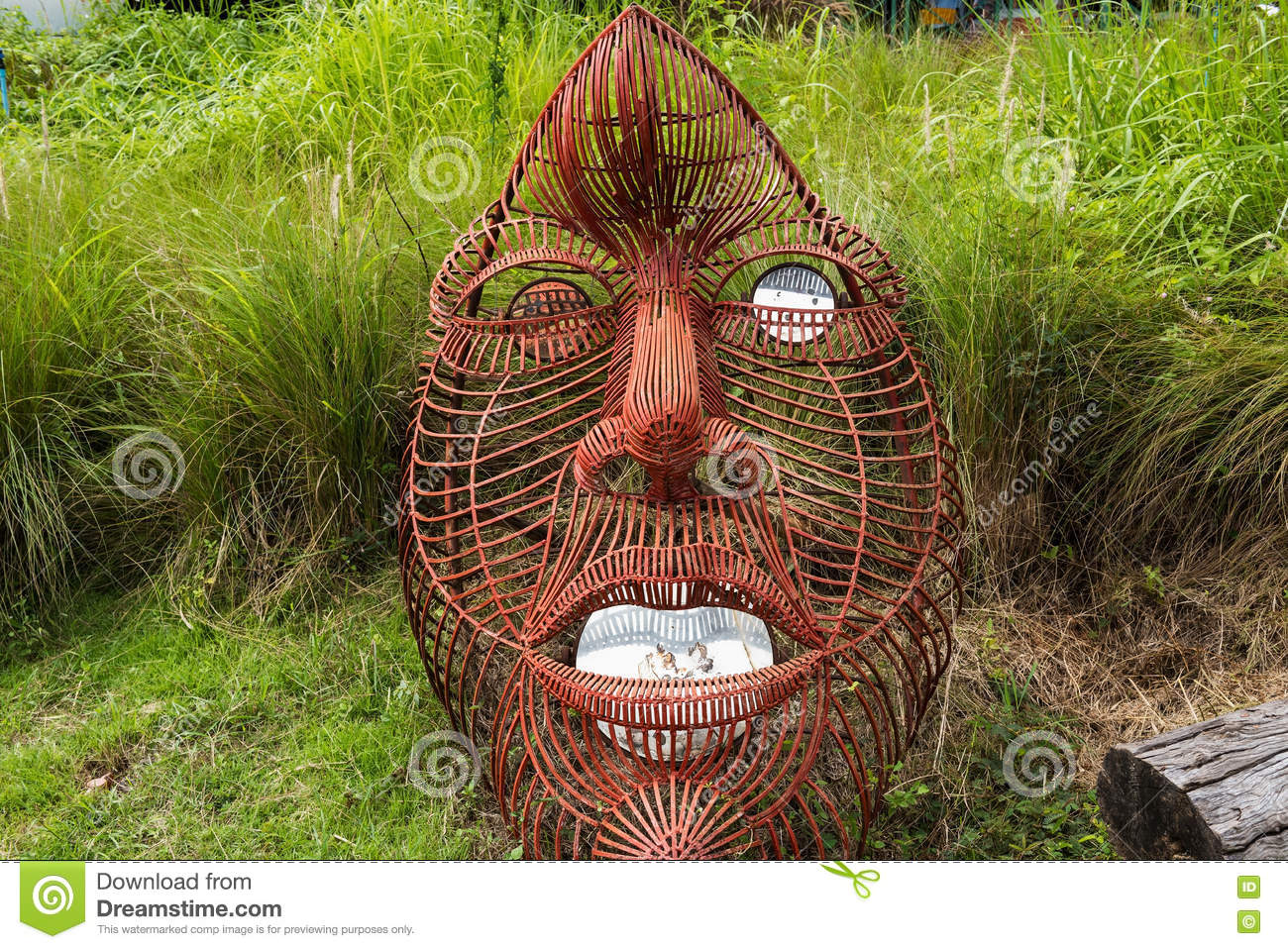 Big Red Iron Face At Garden Stock Image - Image of robot, background ...