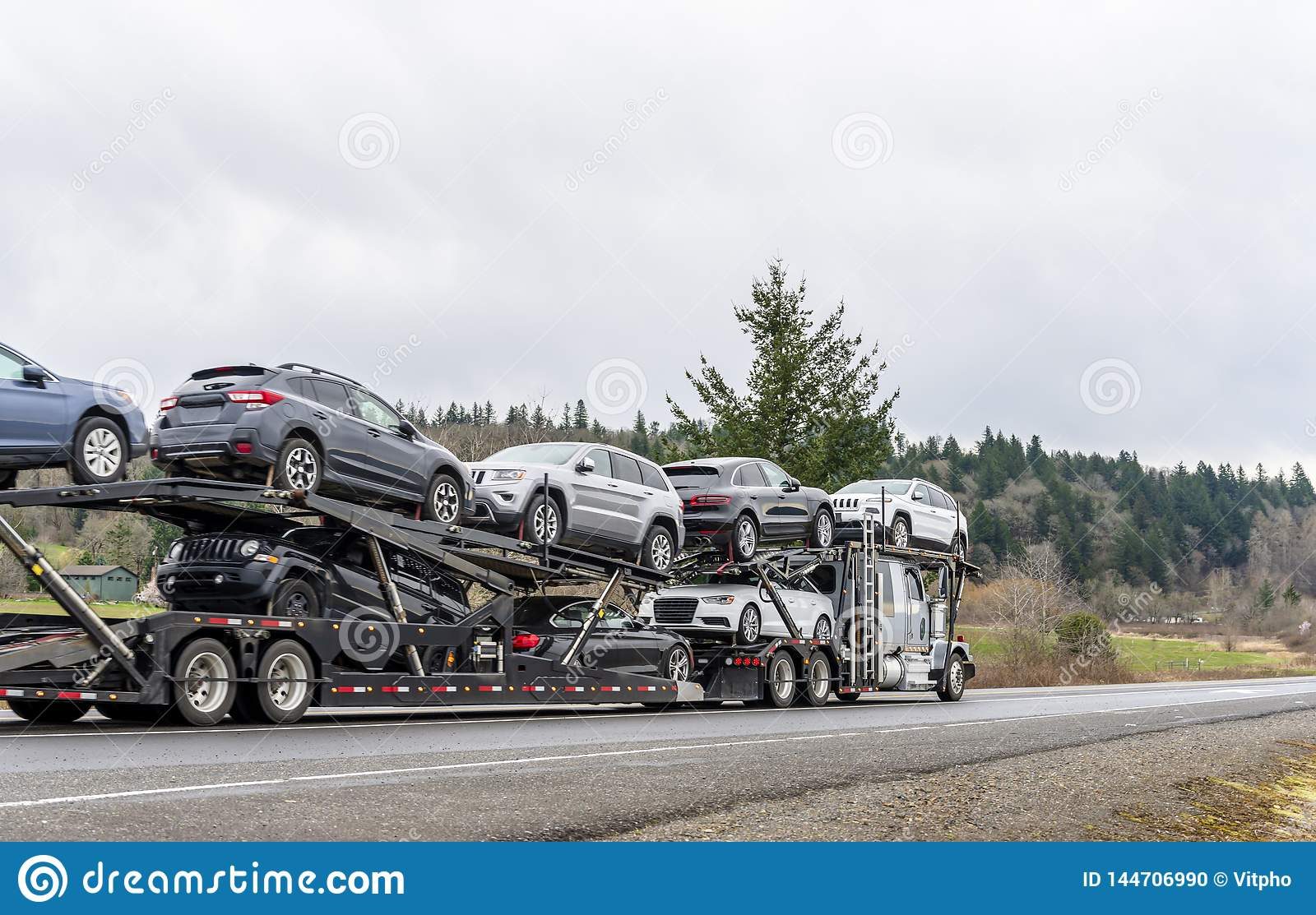 Big Rig Car Hauler Semi Truck Transporting Cars On Special Two Level