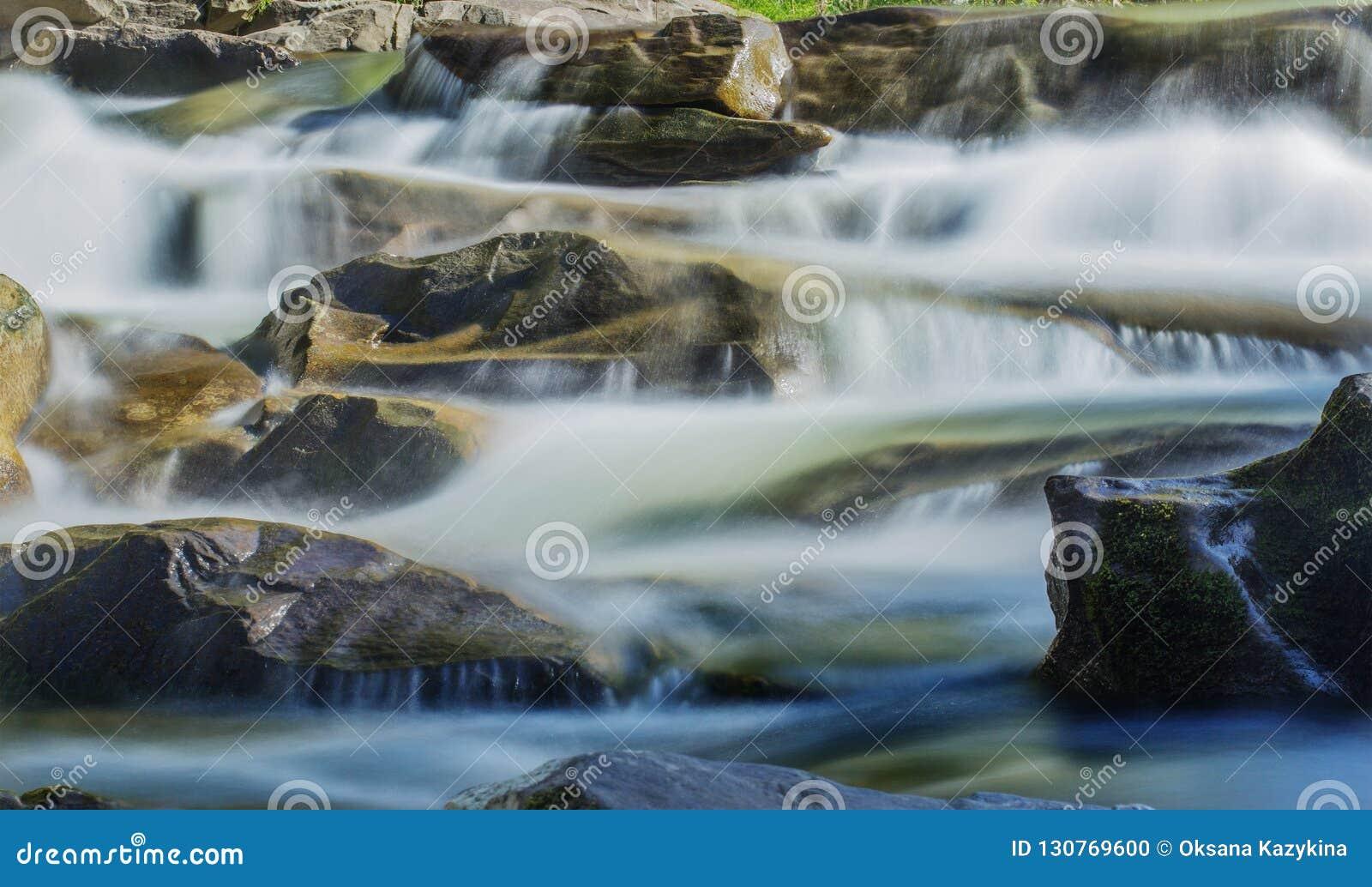 Big rocks in waterfalls of mountains river mountains. Water mountains landscape. Idea for outdoor activities, travel.