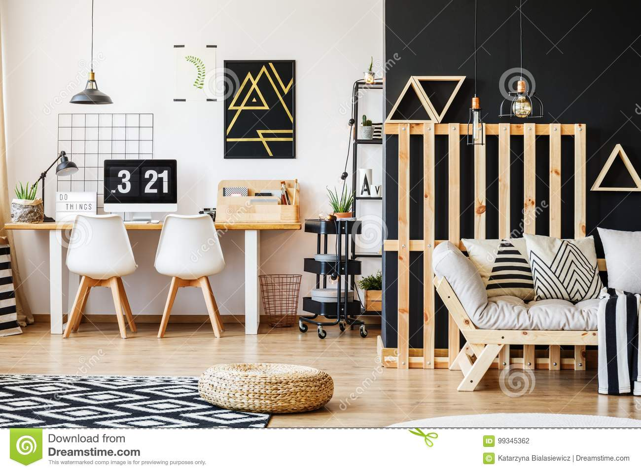 Big scandi desk designer chairs computer poster and rack in modern cozy room for a teenager with black and white interior design and wooden pallet decor