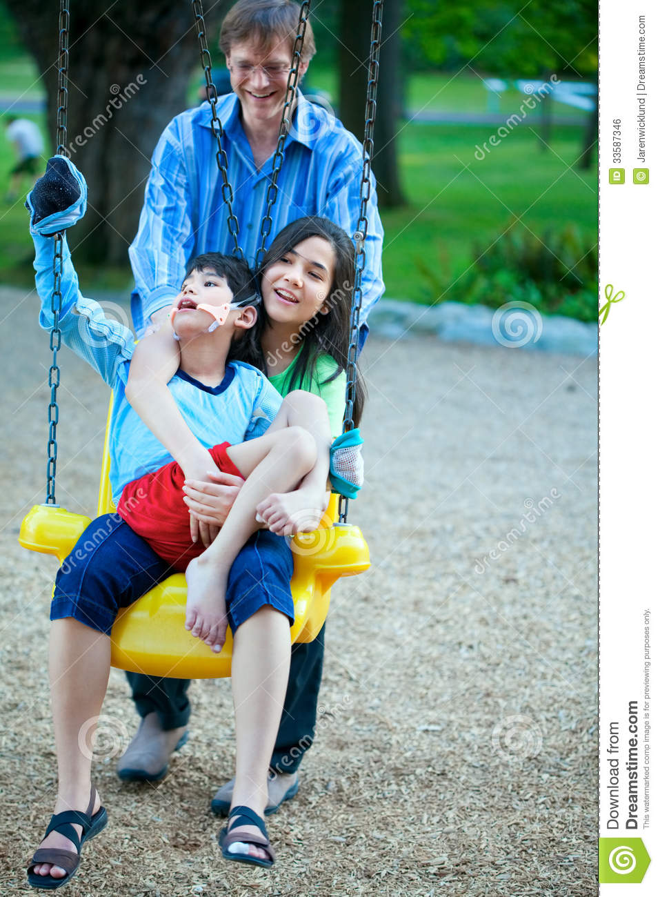 Big Sister Holding Disabled Brother On Special Needs Swing ...