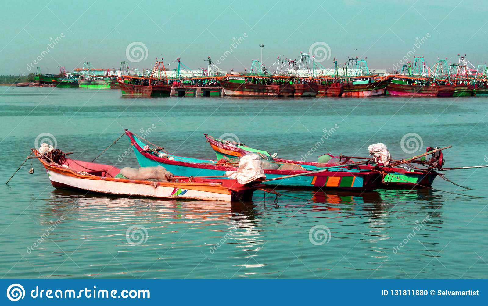 The big and small boats parked in the river arasalaru to ready to catch fish.