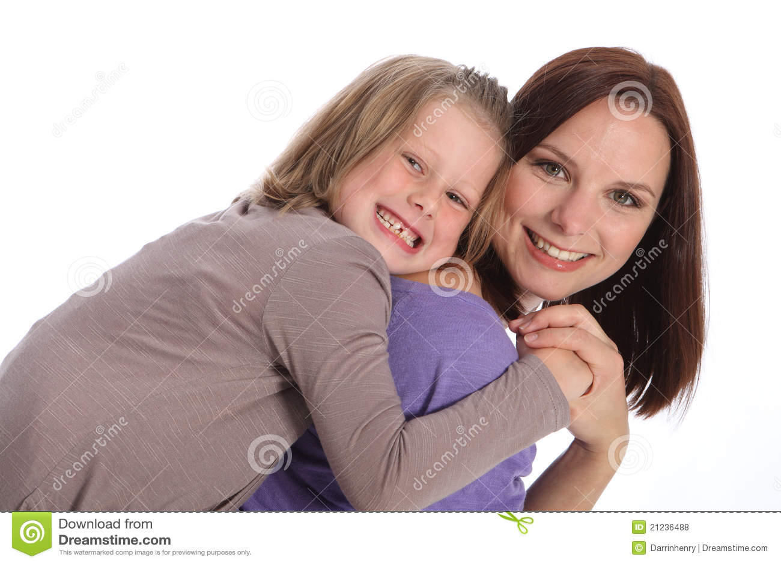 Big smiles mother and daughter piggy back fun