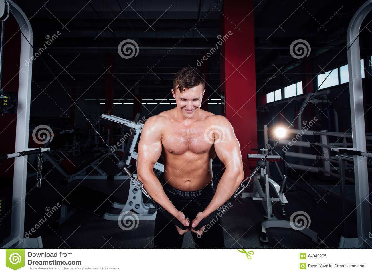 Big Strong Bodybuider Without Shirts Demonstrate Crossover Exercises