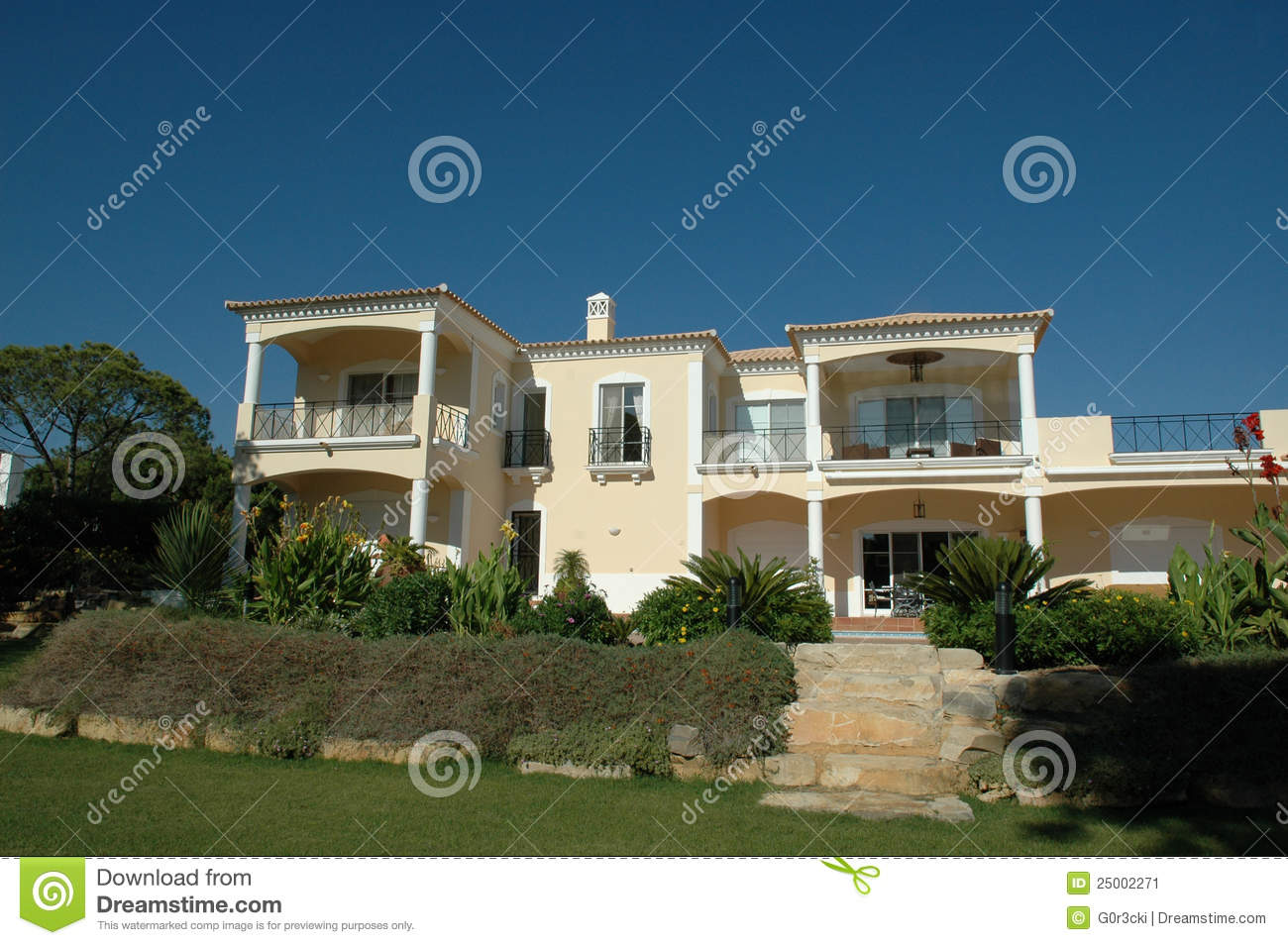 backyard of a modern house with a big and beautiful garden and a