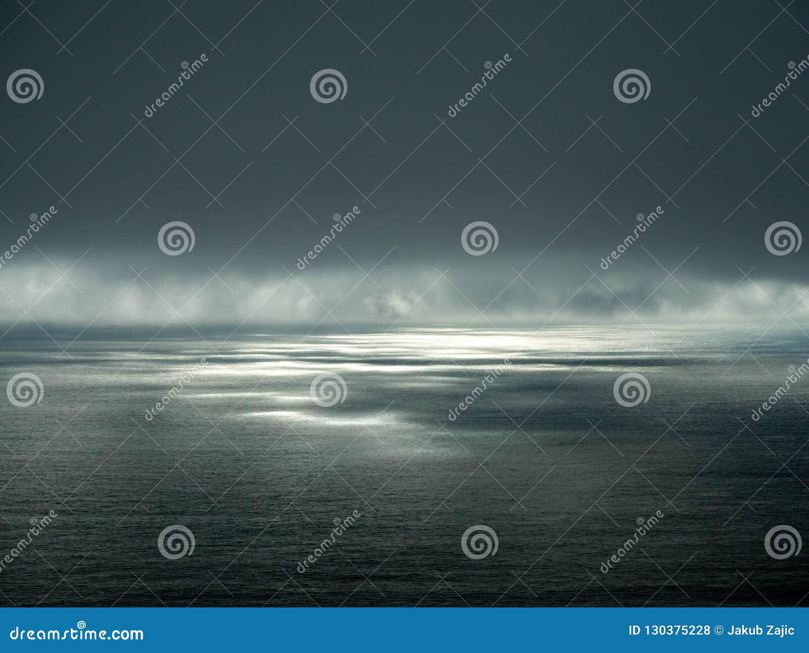 Big Sur California coast, bridge, beach, rocks, clouds, and surfing waves