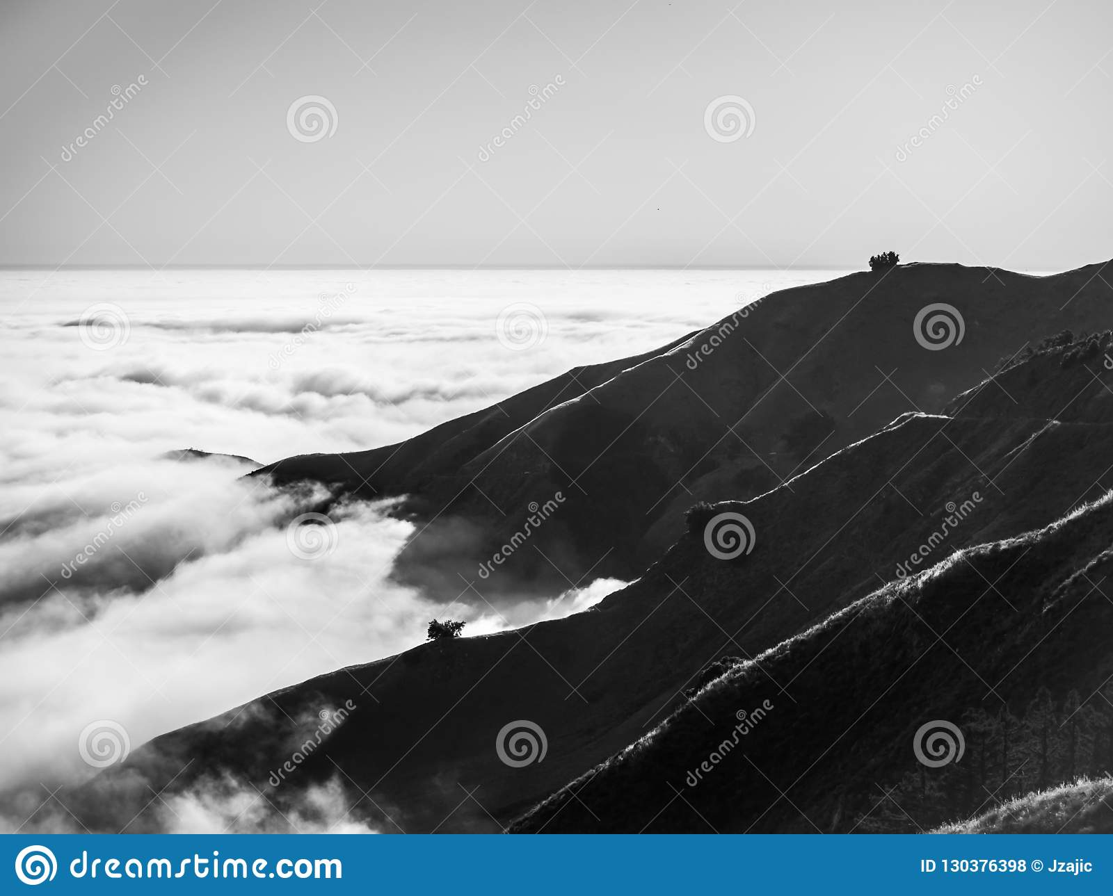 Big Sur California coast, bridge, beach, rocks, clouds, and surfing waves, black and white art photography