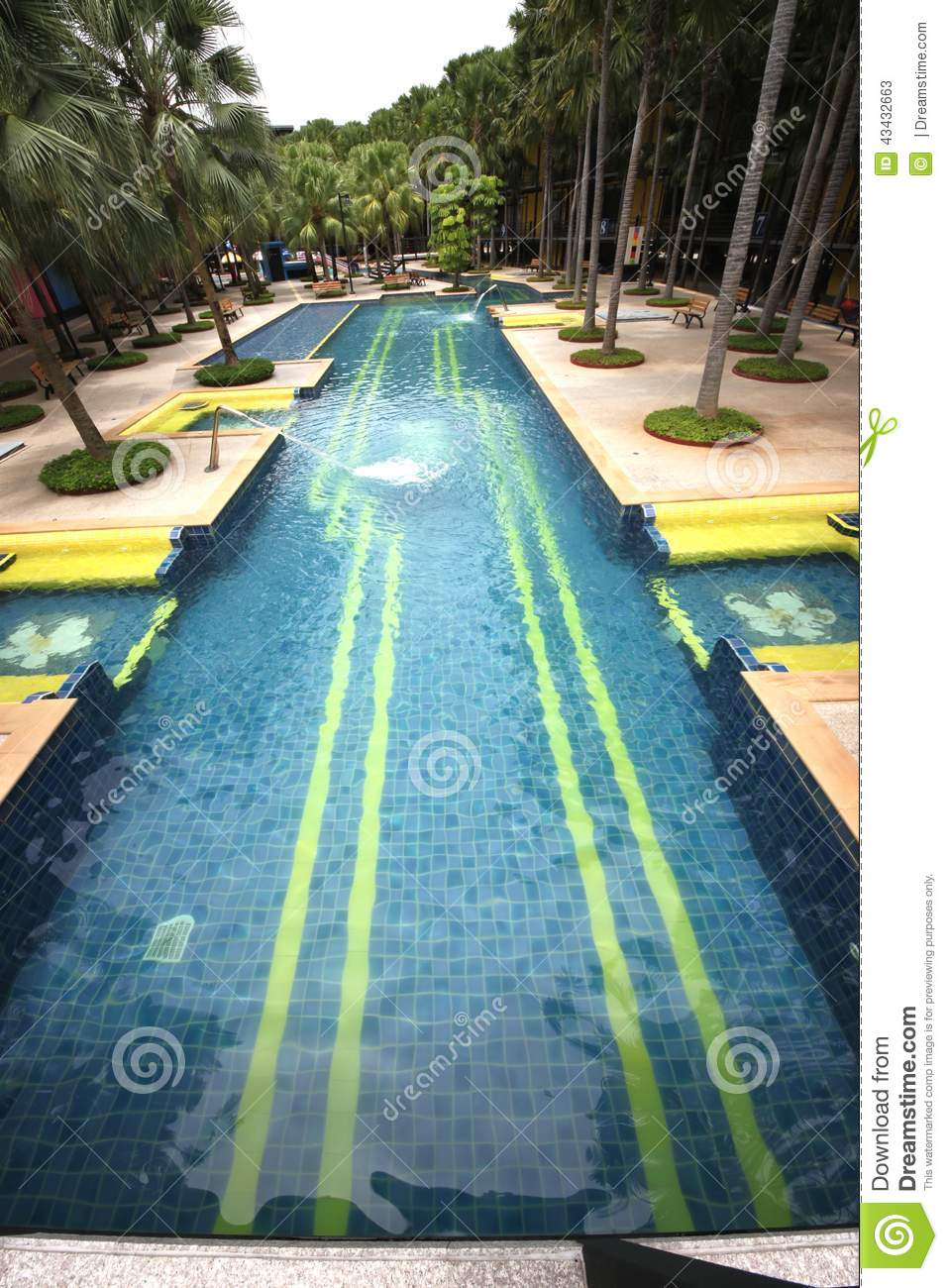 A big swimming pool with clear water and seats in water in for Big swimming pools for gardens
