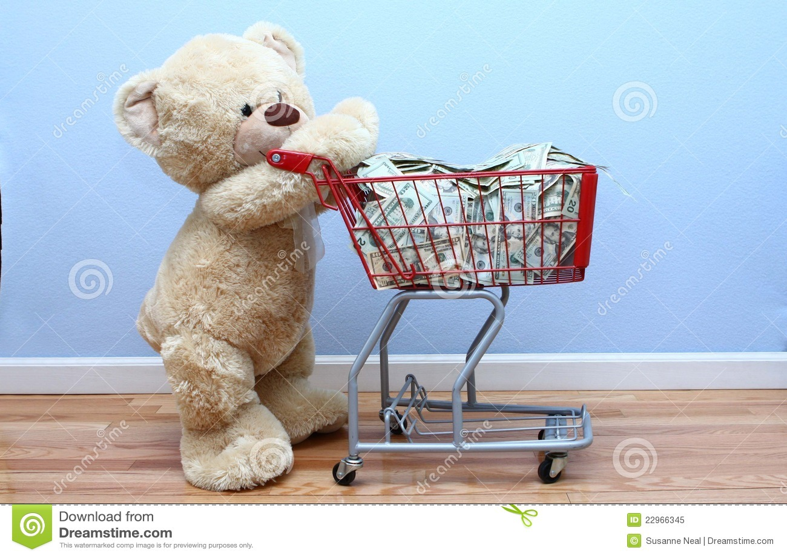 Big Teddy Bear Pushing Money In Shopping Cart Stock Image