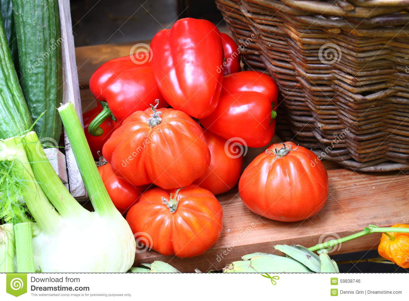 Big Tomatoes and Paprika with Wooden Bucket and Other Vegetables on Table