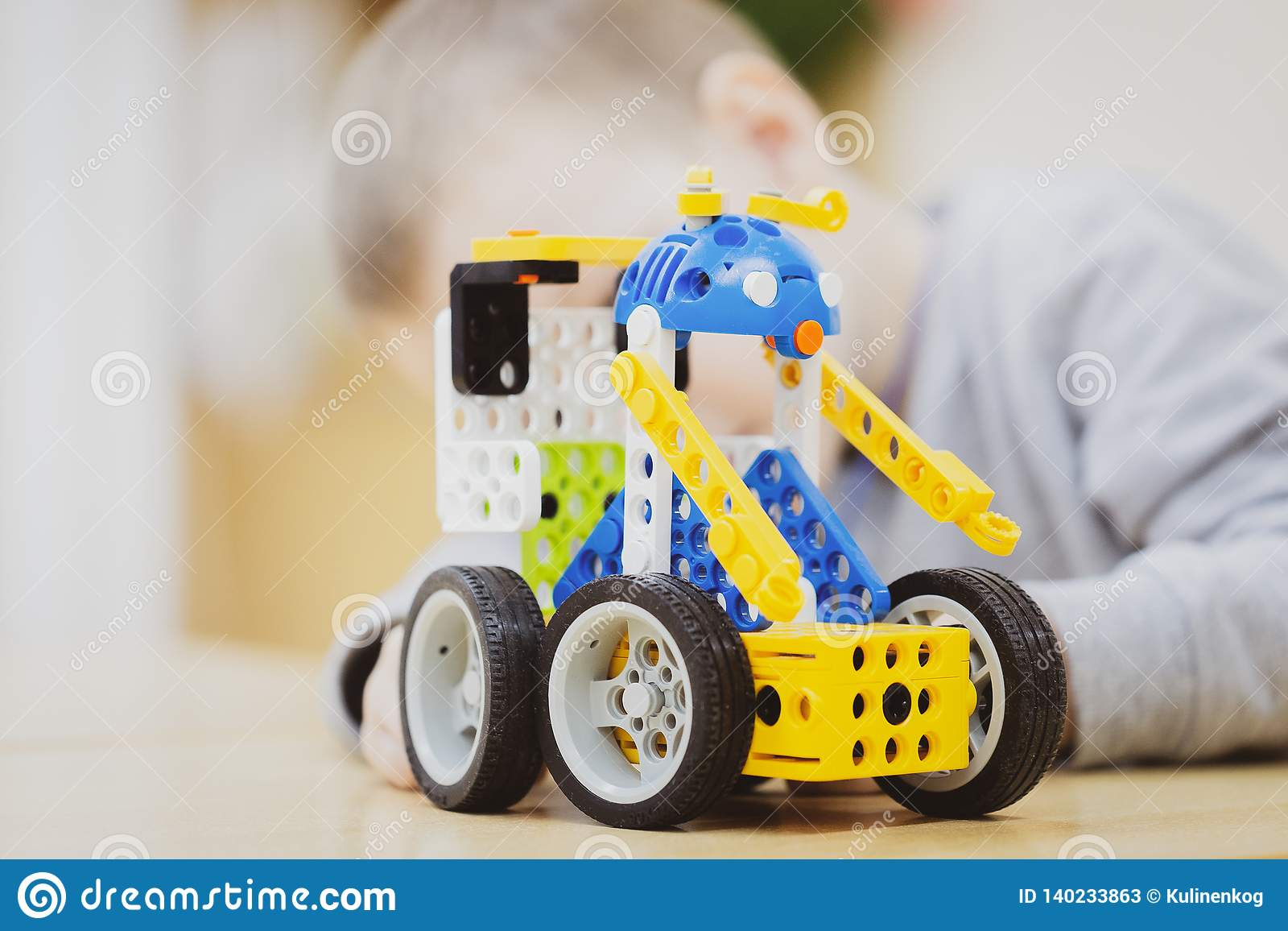 Big toy constructor machine is on the table as a gift to the boy