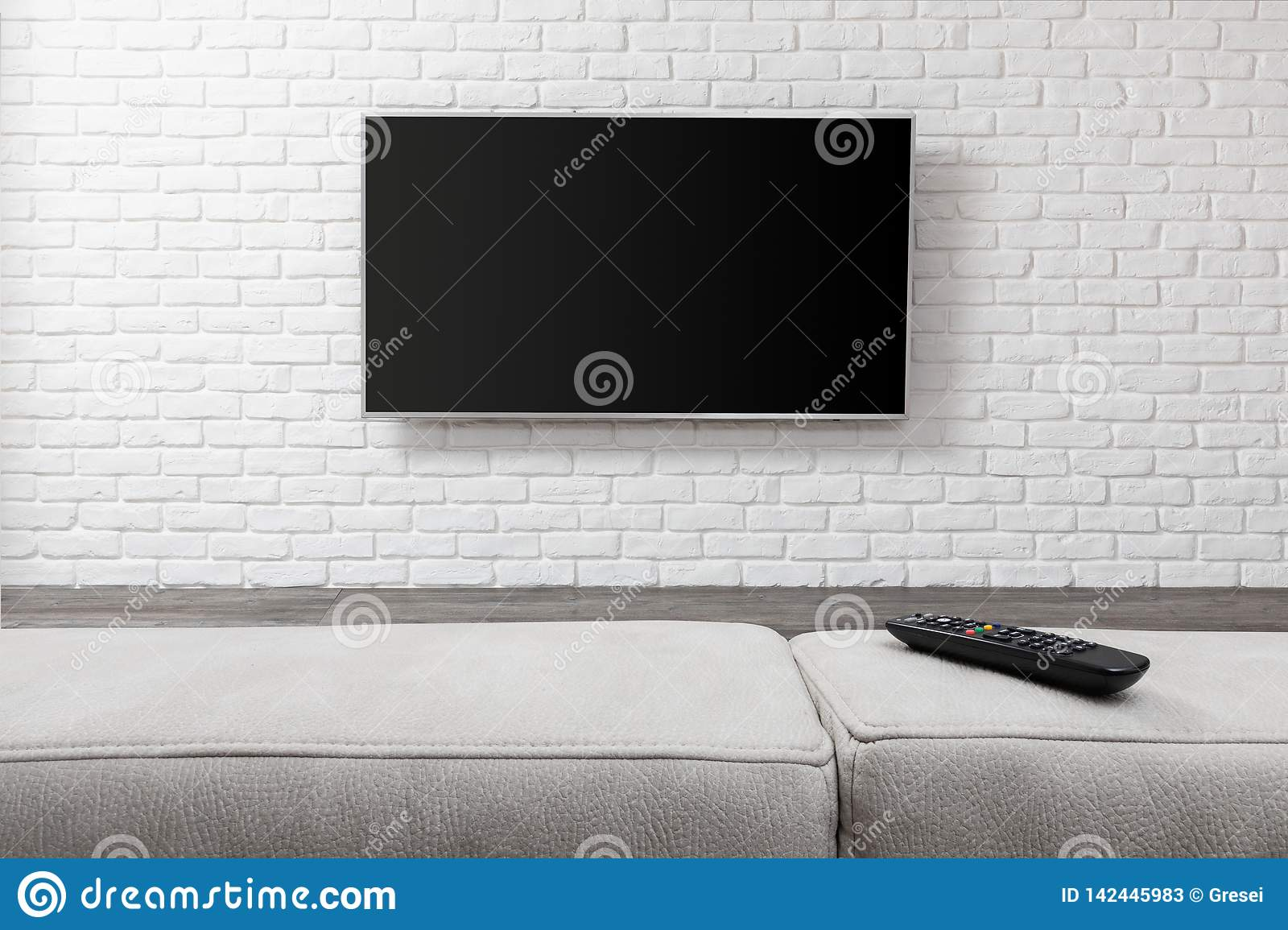 Big TV on the white wall