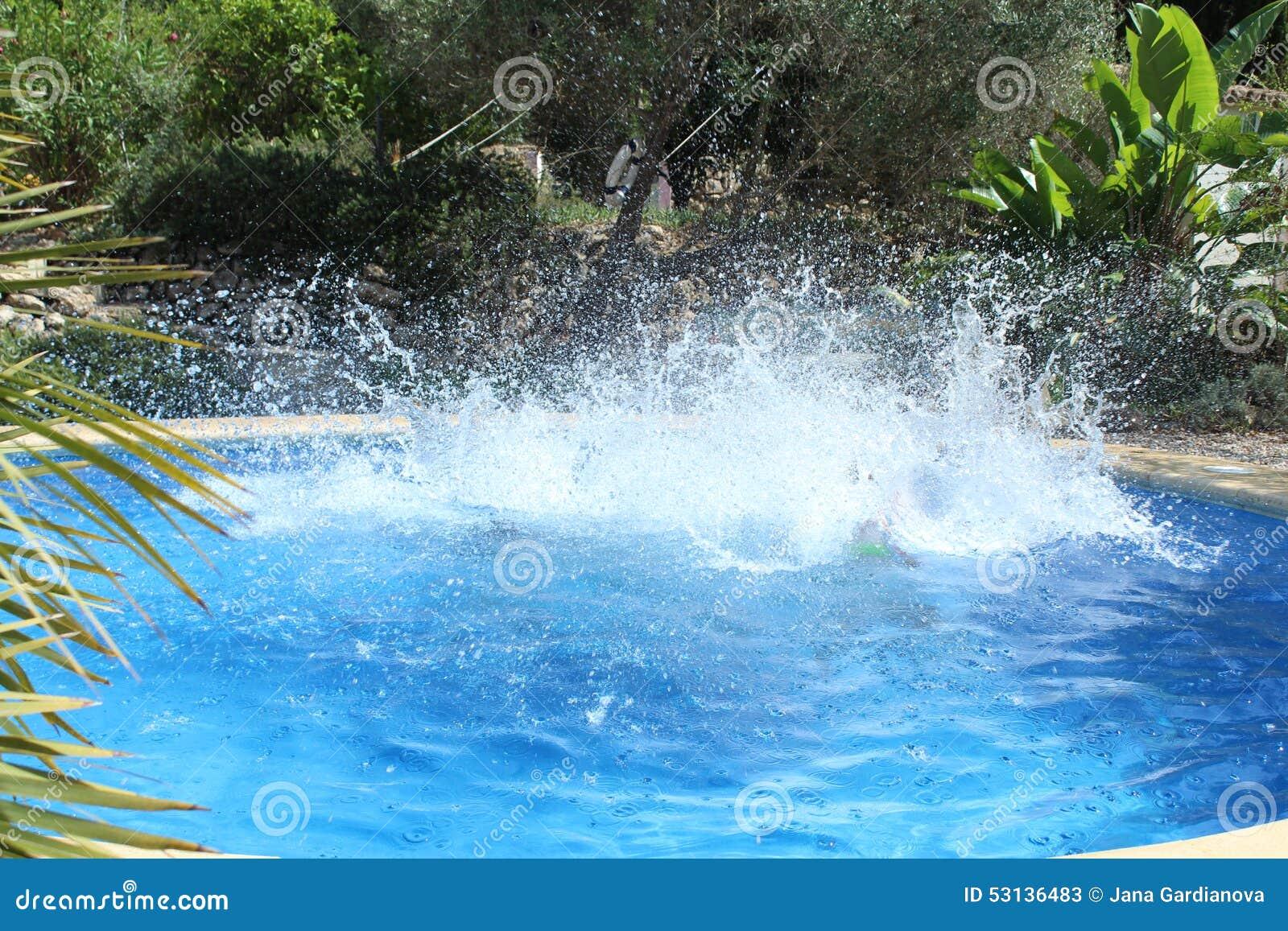 Pool Water Splash big water splash in the pool stock photo - image: 53136483