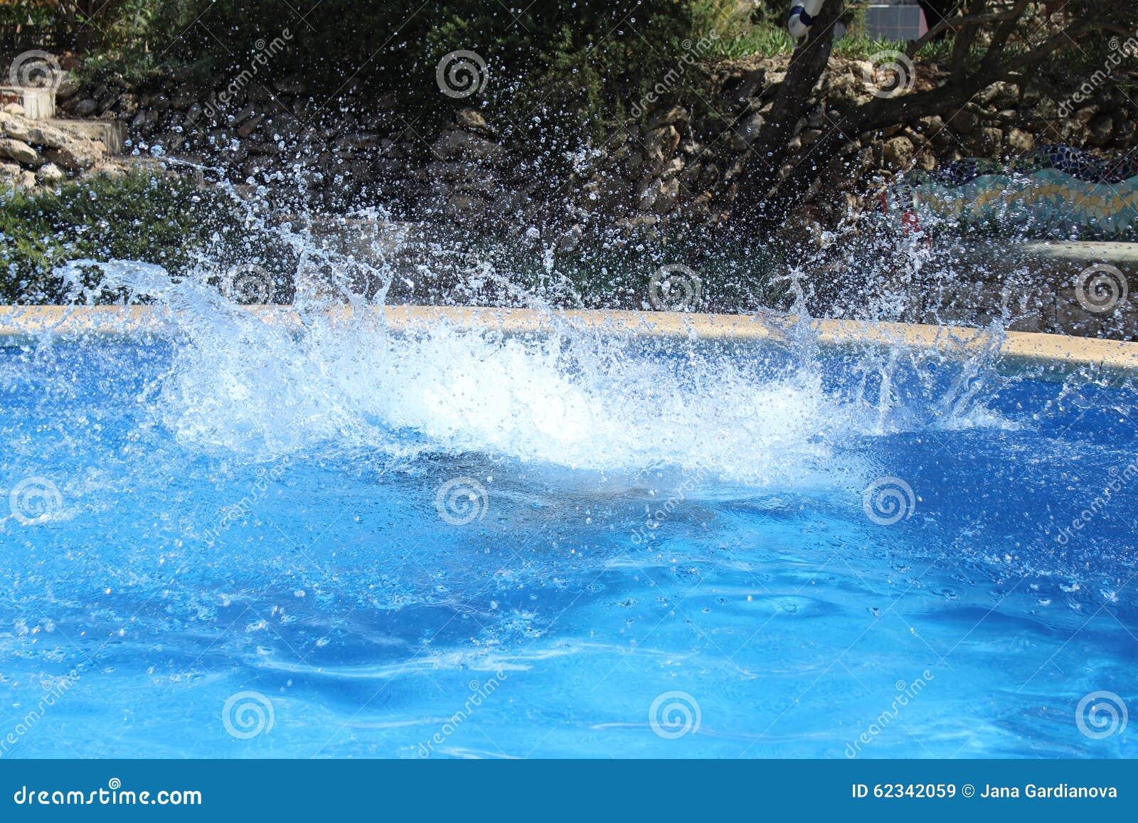 Pool Water Splash big water splash stock photo - image: 62342059