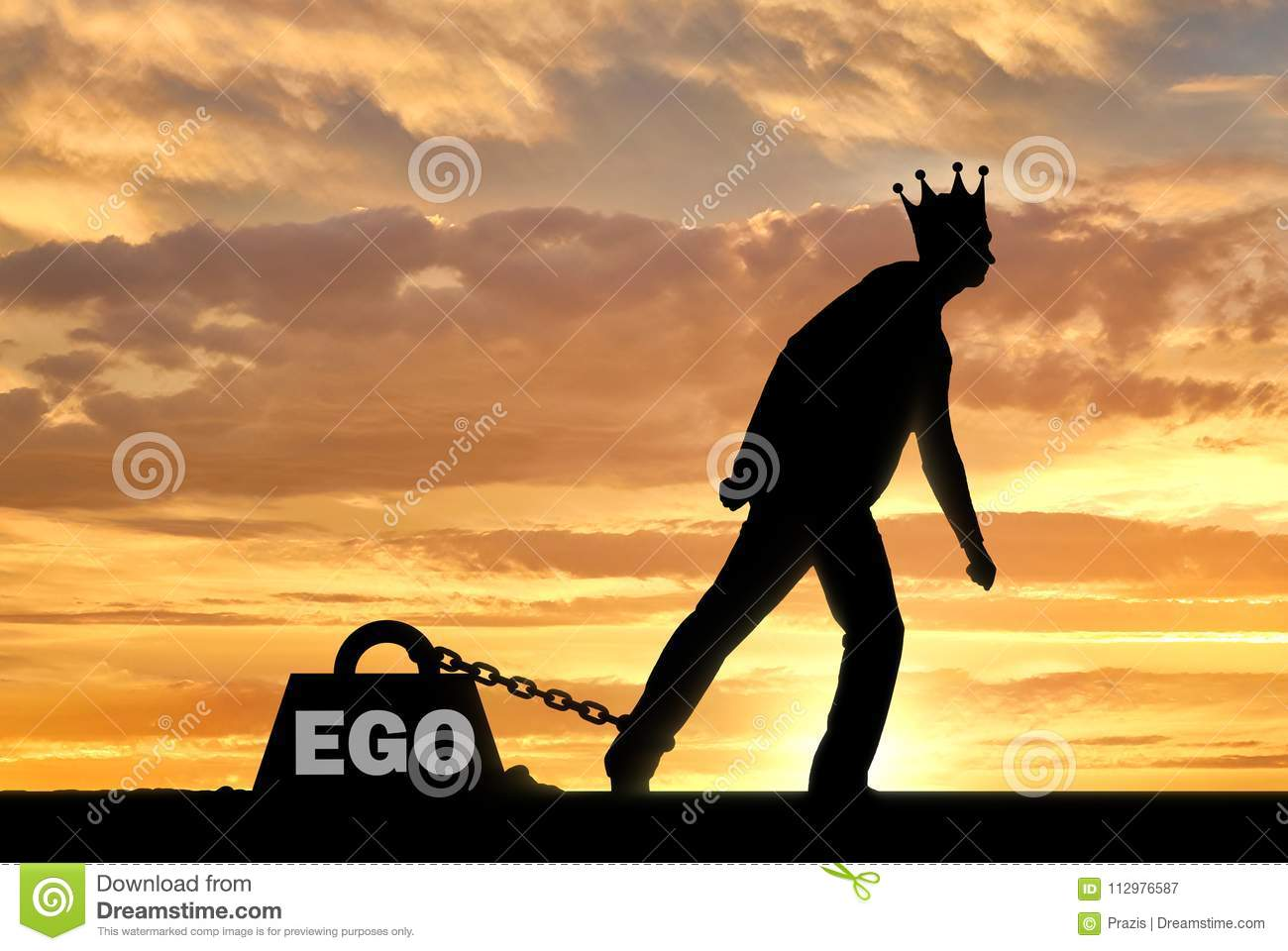A big weight in the form of an ego is chained to the foot of a selfish and narcissistic man with a crown on his head
