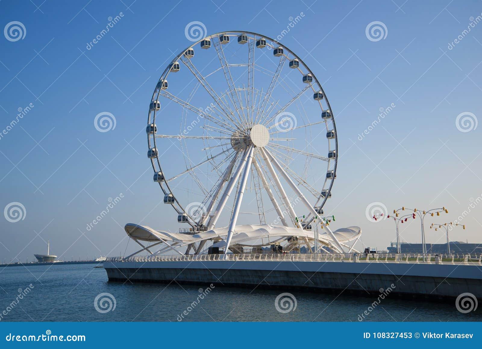 Big wheel on the embankment of the Caspian Sea in the sunny day. Baku, Azerbaijan