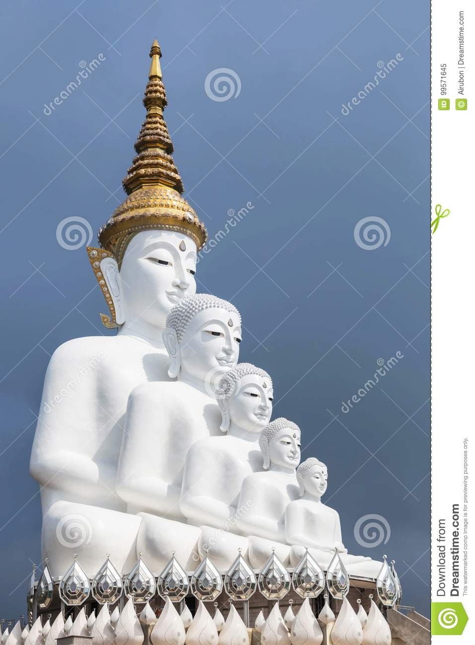 Big white buddha statues sitting on valley mountain with fog in Wat Phra That Pha Son Kaew Thailand.