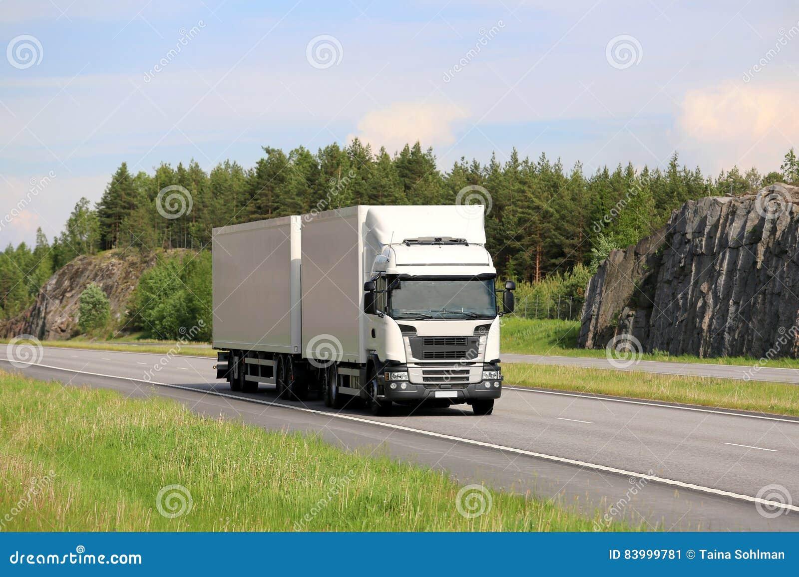 Big White Cargo Truck on Motorway